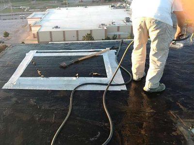 Raintite crewmember on black commercial roof