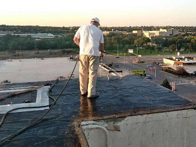 Raintite crew member repairing roof
